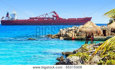 Lifeguard Hut And Huge Container Ship On Mexican Coast
