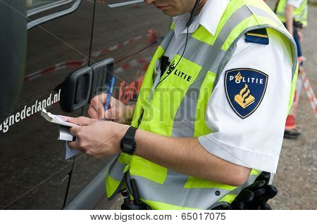 Policeman Is Checking Driving License