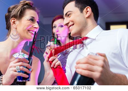 Woman flirting with barkeeper in cocktail bar