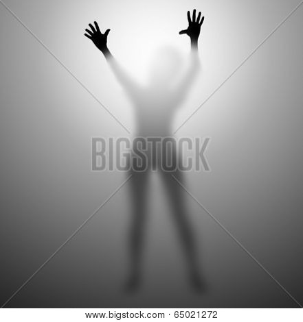 Silhouette of a woman trying to escape from behind a glass screen