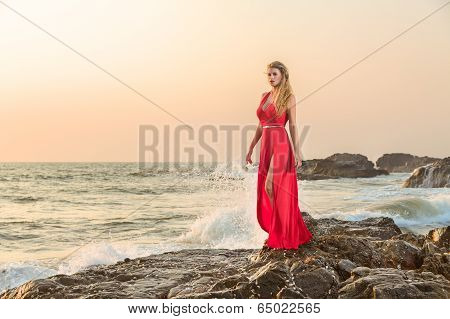 Woman In Long Dress In Front Of Sea