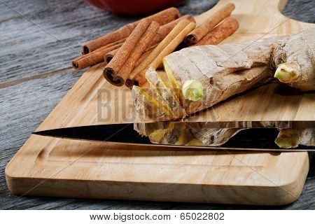 Kitchen Knife Ginger Cinnamon On A Chopping Board