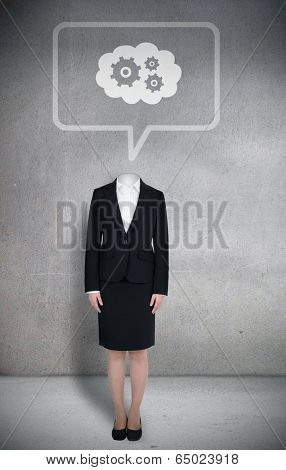 Composite image of headless businesswoman with cogs in speech bubble in grey room