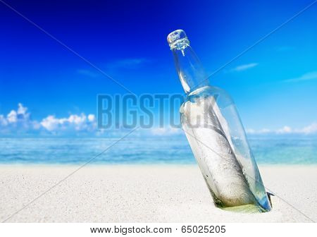 Message in a bottle on a beach.
