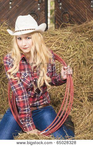 Sensual Passionate Caucasian Cowgirl With Lasso Rope In Farm