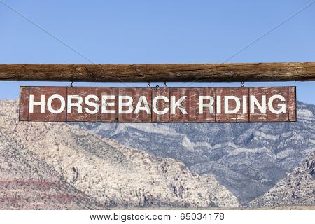 Vintage overhead Horseback Riding sign in a federal owned desert conservation area.