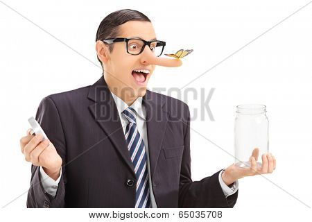 Businessman with butterfly on his nose holding a jar isolated on white background