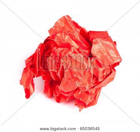 Screwed up piece of red paper isolated on white background