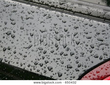 Water Beads On Black Car