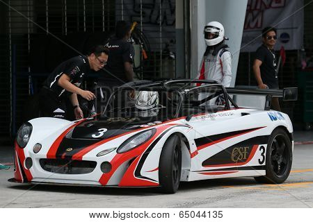SEPANG, MALAYSIA - MAY 10, 2014: The race car of CM Wong undergoes check during the pit-stop at the free practice session of the Malaysian Super Series Round 2 in Sepang International Circuit.