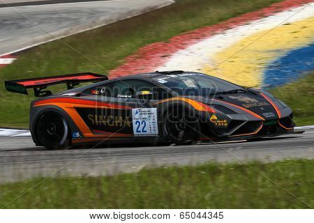 SEPANG, MALAYSIA - MAY 10, 2014: The Lamborghini LP600 car of Sanchai Engtrakul takes to the track at the Thailand Supercar GT3 race of the Thailand Super Series Rd 1 in Sepang International Circuit.