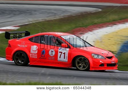 SEPANG, MALAYSIA - MAY 10, 2014:The Honda Integra car of Supachai Weeraborwornpong takes to the track at the Thailand Super 2000 race of the Thailand Super Series Rd 1 in Sepang International Circuit.