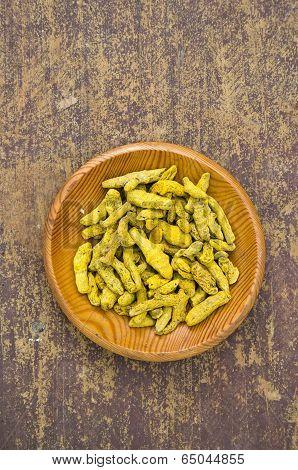 Turmeric (curcuma Longa) Dry Roots In Wooden Plate On Table