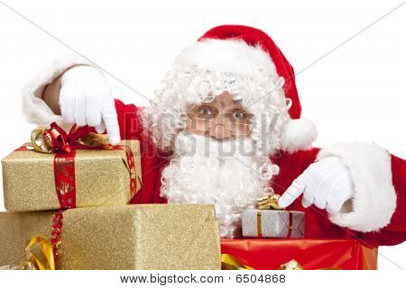 Santa Claus Behind Christmas Gift Boxes Is Pointing With His Fingers On Them