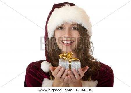 Young Happy Woman With Santa Claus Costume Is Holding Christmas Gift In Hands