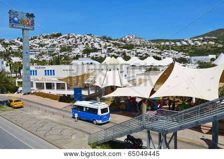 BODRUM, TURKEY - APRIL 13, 2014: Shopping center Oasis against hills. Opened in 1998, this first shopping and culture center in Bodrum is still popular today