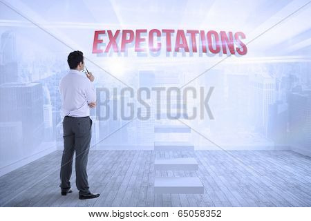 The word expectations and businessman holding glasses against city scene in a room