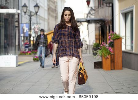 Portrait of a Beautiful fashionable woman in the street