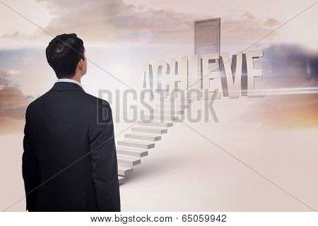 The word achieve and asian businessman against white steps leading to closed door