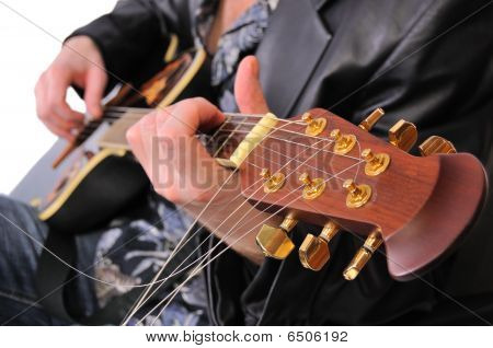 Musician Plays His Acoustic Guitar