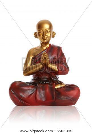Monk Praying Over White