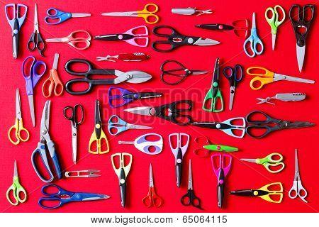 Display Of Multiple Scissors On Red