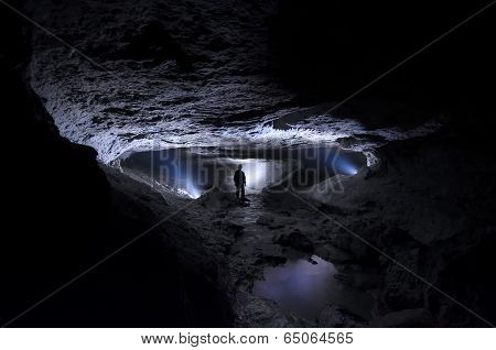 Cave with man explorer