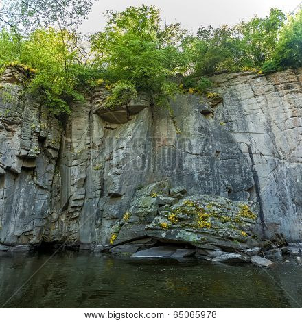 Photo Of High Rock Wall On Mountain River
