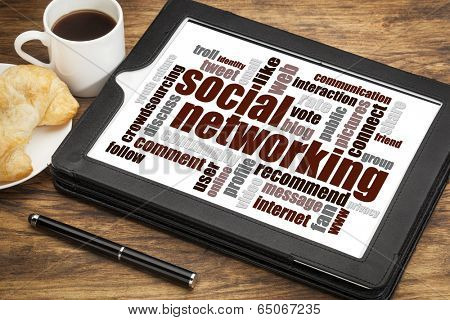 social networking word cloud on a digital tablet  with a cup of coffee