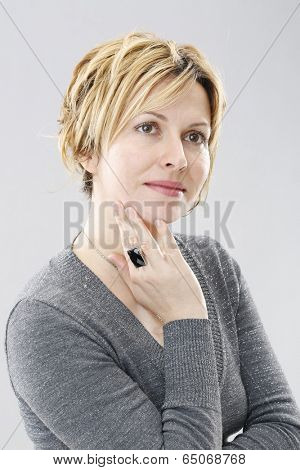 Satisfied 40 years old woman with wrinkles on face