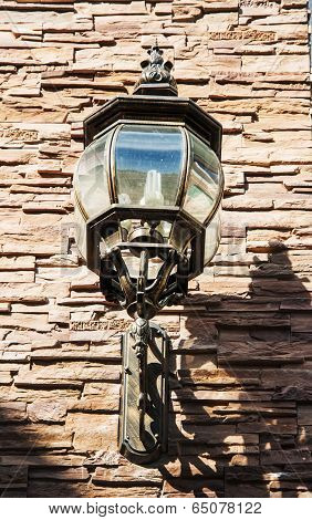 Close Up Vintage Street Lamp Style With Led Lighter On Brickwork Wall In Sunset Time