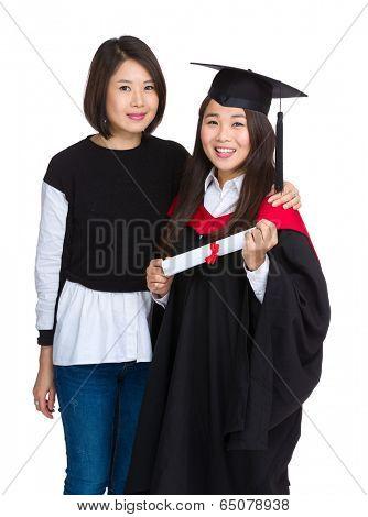 Graduation girl with older sister