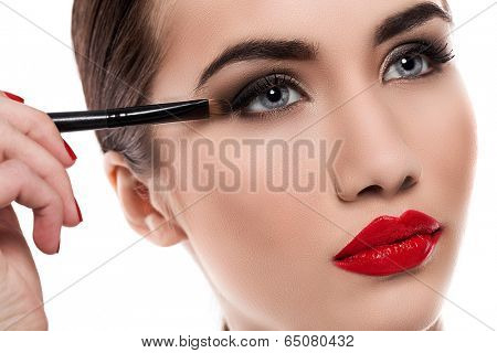 Gorgeous girl during makeup