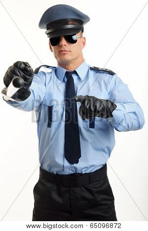 Young policeman shows on you