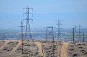 stock photo of transmission lines  - High voltage transmission lines occupy the utility company - JPG