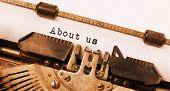 foto of old vintage typewriter  - Vintage inscription made by old typewriter about us - JPG