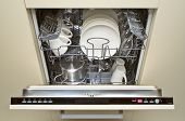 image of dishwasher  - open dishwasher loaded with cups - JPG