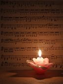 pic of candle flame  - Candle flame with old Music note for background  - JPG