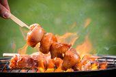 foto of braai  - Tasty skewers on the grill - JPG