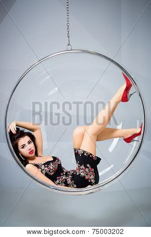 Sexy Woman Suspended From An Aerial Hoop