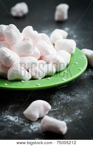Homemade pink marshmellows on dark rustic background