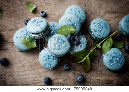 Close up of blueberry macaroons with white filling