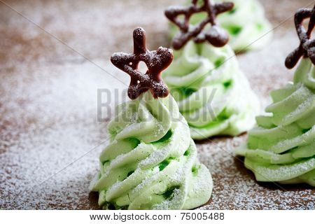 Close up of green christmas tree meringues