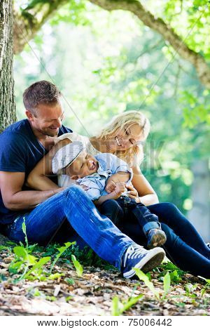 Young family in the park with their son