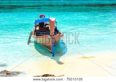 Lipe, Satun, Thailand - Sep 27, 2014: Fisherman Sailed Longtail Boat To Visit Beautiful Beach Of Koh