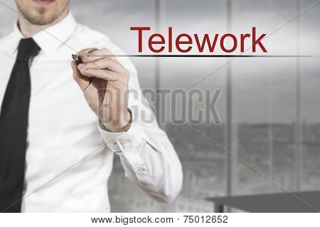 Businessman Writing Telework in office