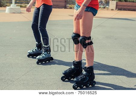 Two Women Rollerblading