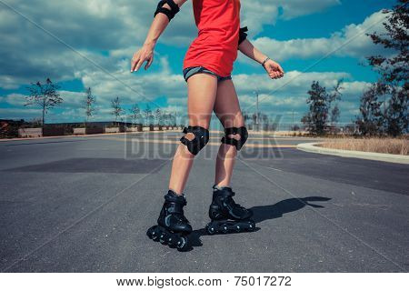 Young Woman Rollerblading On Sunny Day