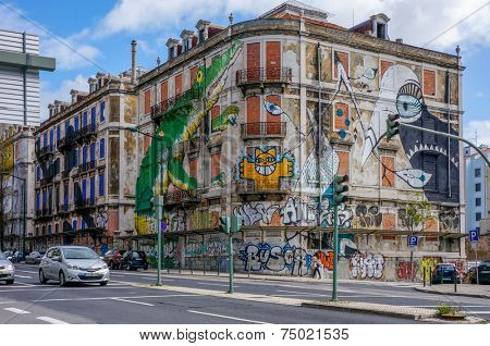 LISBON, PORTUGAL - MAY 2, 2012 - The old abandoned house, located on Avenida Fontes Pereira de Melo with big green crocodile painted on it, on May 2 in Lisbon.