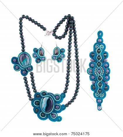 Set of necklace with earrings and bracelet.